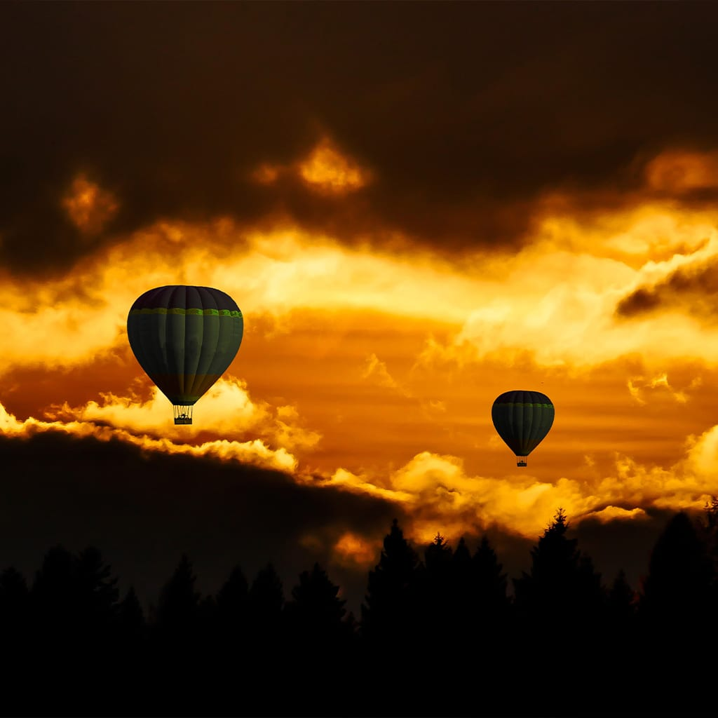 Gold sky with hot air balloons