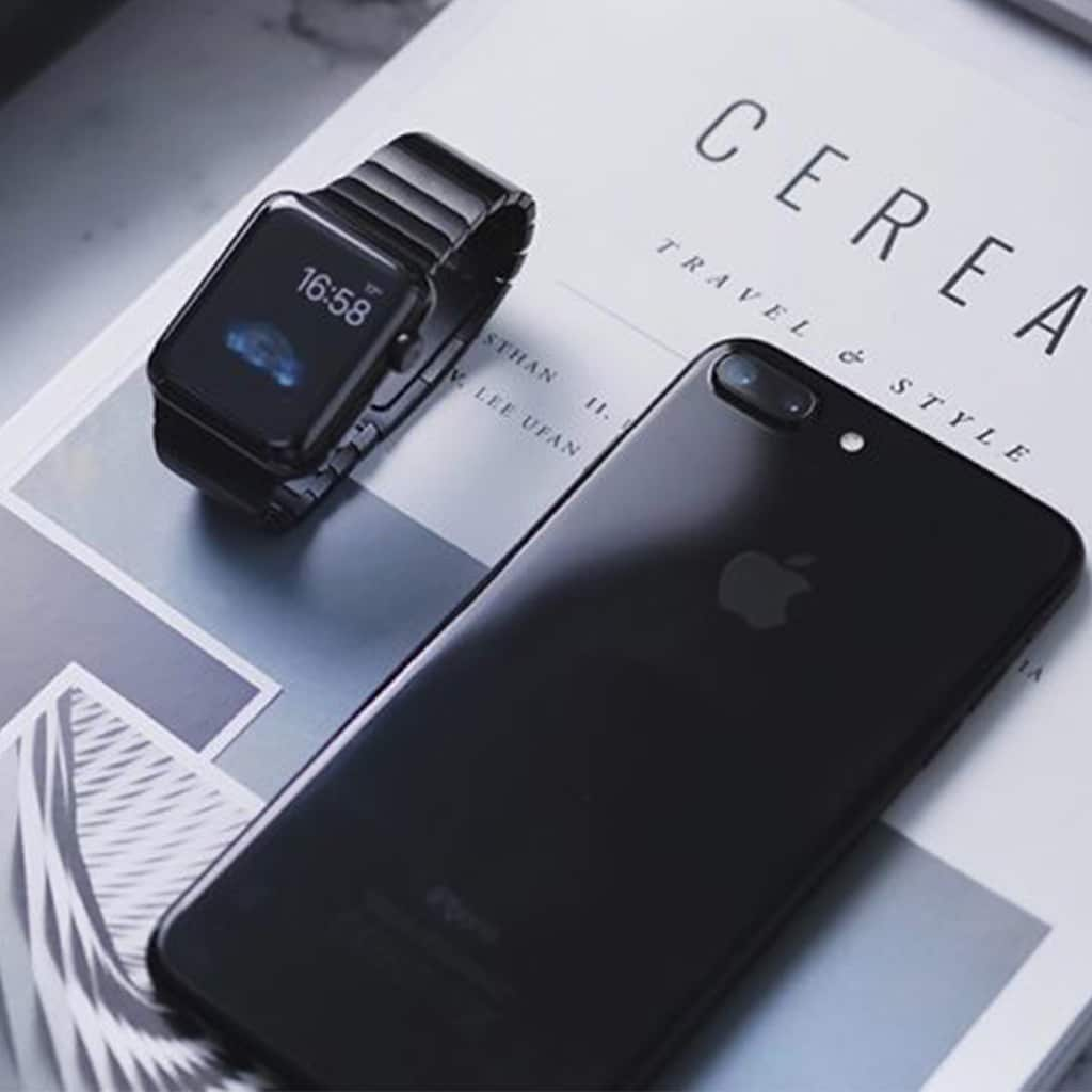 corporate travellers phone and watch on travel magazines