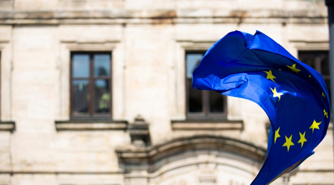 The eu flag waving with news of open borders to Candians