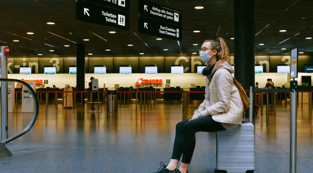 Lady sat in airport lounge news of border restrictions
