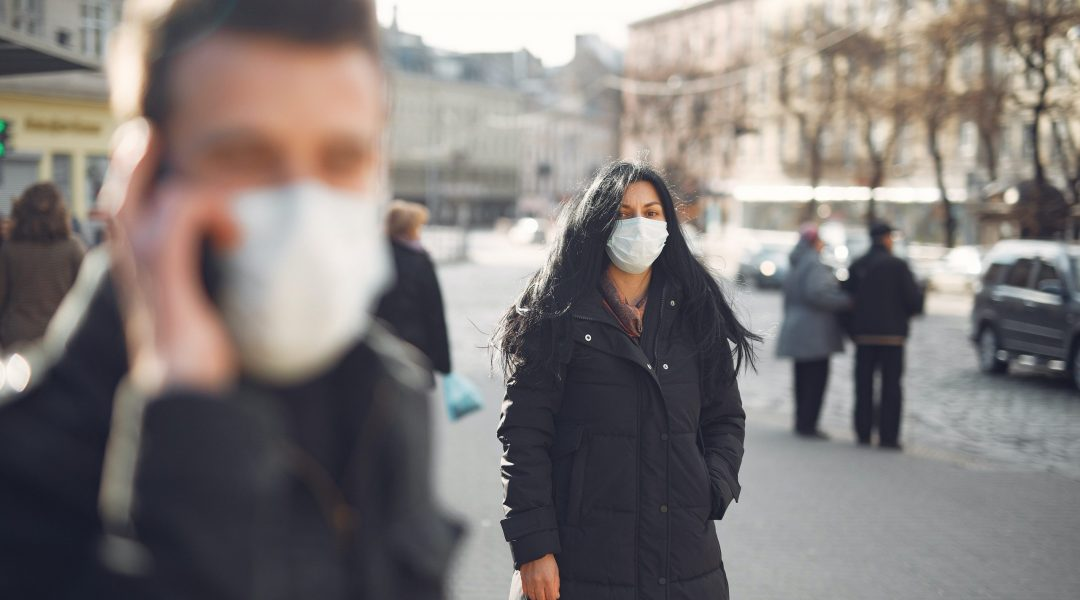covid travel advisory discourages American tourists picture wearing masks